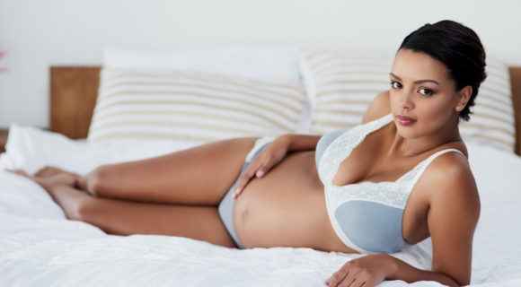 Pregnant lady lies in nursing bra for large breasts