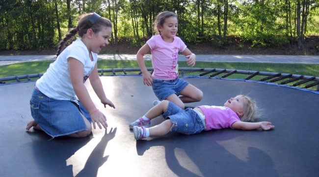 """Girls play a """"Dead Man Rise"""" game on the trampoline"""