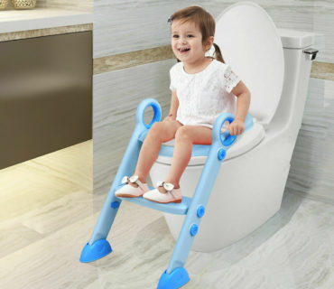 Little girl sits on toilet