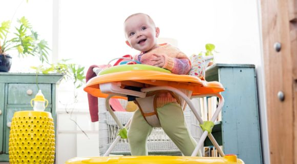 Baby girl playing in walker