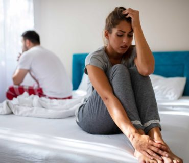 Stressed couple having cramping after sex problems.